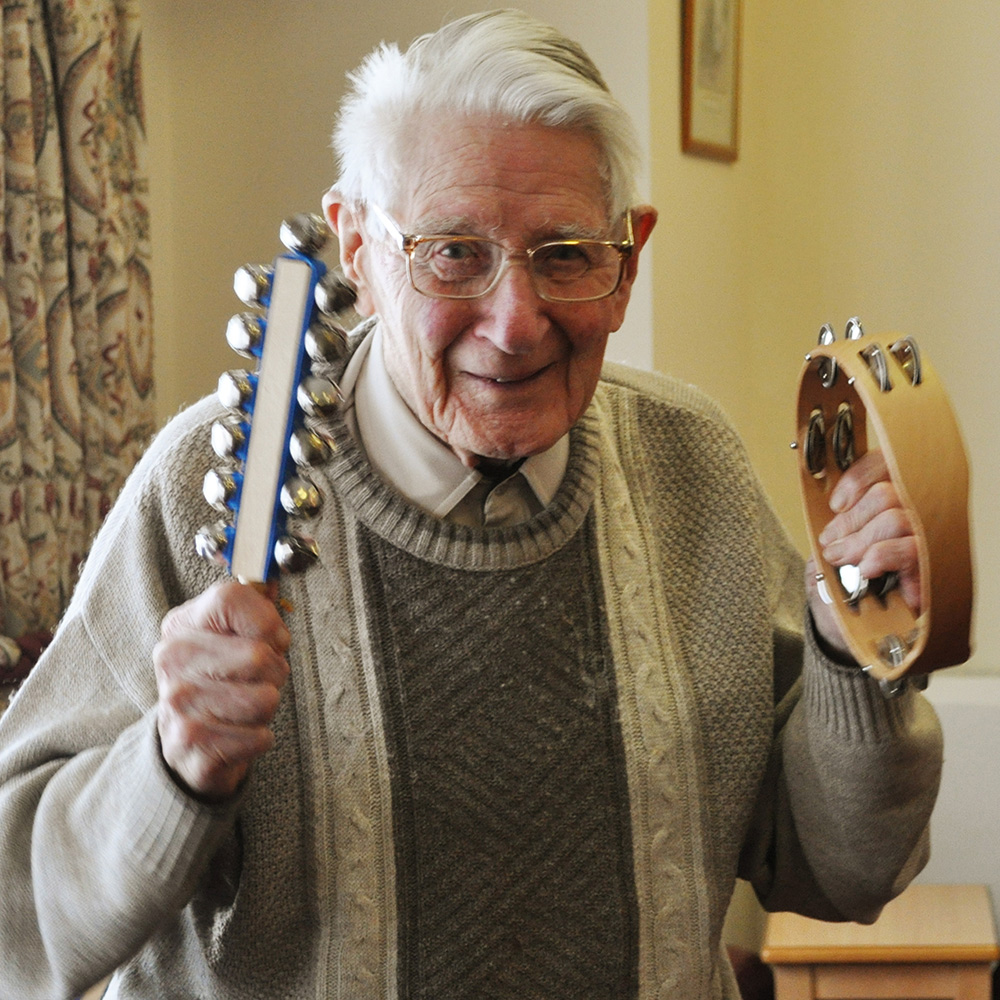 Dementia care resident playing instruments